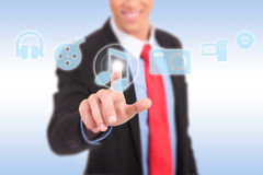 Business man pressing a MUSIC button Royalty Free Stock Image