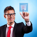 Business man pressing a shopping button Royalty Free Stock Image