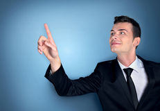 Business man pressing. Something on blue Royalty Free Stock Photo