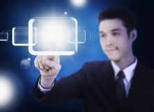Business man pressing a touchscreen Stock Images