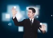 Business man pressing a touchscreen Stock Image