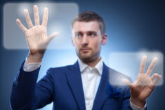 Business man pressing touchscreen button Stock Image