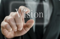 Business man pressing Vision button on a touch screen interface. Close up of business man hand pressing Vision button on a touch screen interface royalty free stock photos
