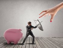 Business man protects financial capital from the tax office fighting with sword and shield. 3D Rendering. Business man protects a piggy bank fighting against a royalty free stock images
