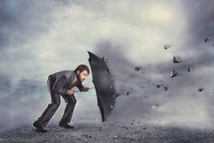 Business man protects himself from the crisis Stock Photos