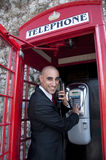 Business Man on the public phone Stock Photography