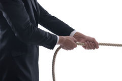 Business Man Pulling And Bond Tied With Rope Conc Stock Image