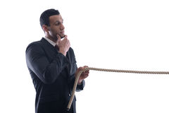 Business Man Pulling And Bond Tied With Rope Conc Stock Images