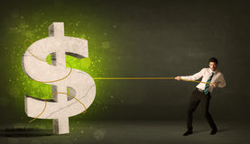 Business man pulling a big green dollar sign. Concept on background Stock Images