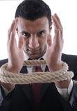 Business man pulling and bond tied with rope  conc Royalty Free Stock Photo