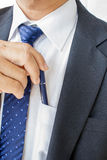 Business man pulling or putting pen Royalty Free Stock Photo