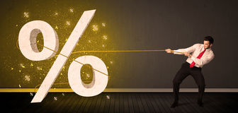 Business man pulling rope with big procent symbol sign Stock Image