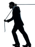 Business man pulling a rope silhouette. One caucasian business man pulling a rope in silhouette studio isolated on white background Royalty Free Stock Photo