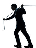 Business man pulling a rope silhouette. One  business man pulling a rope in silhouette studio isolated on white background Royalty Free Stock Image