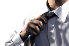 Business man pulling the tie. Isolated stock photo