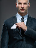 Business man pulls out business card from the pocket Stock Photos