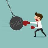 Business man punch big pendulum debt. Royalty Free Stock Photography