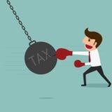 Business man punch big pendulum tax. Stock Photos