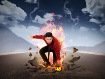 Business man punch the road with blue fire power. Business power conceptual Stock Photo