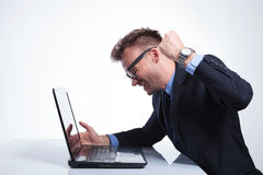 Business man punches his laptop Stock Image