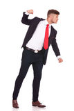 Business man punching someone. Side view of a young business man threatening to punch someone. isolated on white background royalty free stock photography