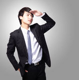 Business man purposefully looking away. Successful handsome business man purposefully looking away to empty copy space isolated on gray background, mode is a Royalty Free Stock Photos