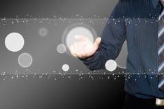 Business man push the button on Digital sheet Stock Photo