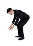 Business man push something down Royalty Free Stock Photography