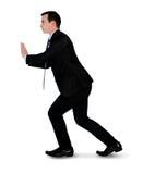 Business man push something. Isolated business man push something Stock Images