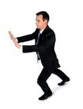 Business man push something Royalty Free Stock Photo