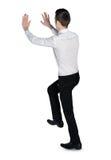 Business man push something. Isolated business man push something Royalty Free Stock Photo