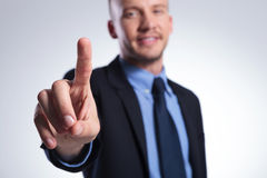 Business man pushes button Royalty Free Stock Photos