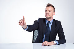 Business man pushes imaginary button Stock Images