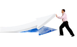 Business man pushing an arrow Royalty Free Stock Images