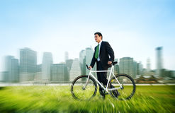 Business Man Pushing Bike Outdoors Concept Royalty Free Stock Photography