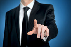 Business man pushing button Stock Photography
