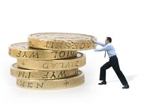 Business man pushing coins - power Royalty Free Stock Image