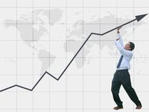 Business man pushing graph to success - statistics Royalty Free Stock Photography