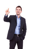 Business man pushing imaginary buttons Stock Photography
