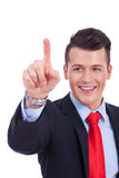 Business man pushing imaginary buttons Royalty Free Stock Photos