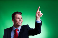 Business man pushing imaginary digital buttons royalty free stock photography