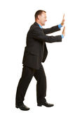 Business man pushing imaginary wall Royalty Free Stock Images