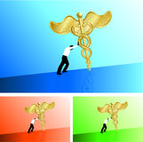 Business man pushing medical caduceus uphill Stock Photography