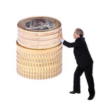 Business man pushing a pile of euro coins. Isolated on white Stock Image