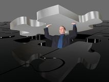 Business man pushing puzzle up Royalty Free Stock Photos