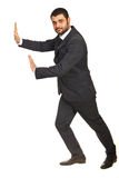 Business man pushing something Royalty Free Stock Photos