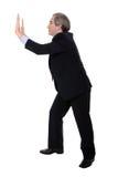 Business man pushing something Stock Photos