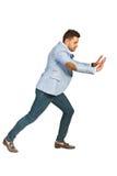 Business man pushing something Stock Photo