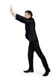 Business man pushing something Stock Images