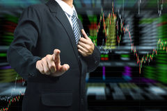 Business man pushing with stock market graph background Royalty Free Stock Image
